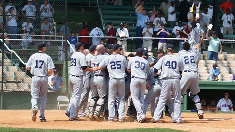 Justin Greene's teammates greet him at home after his walk-off blast.