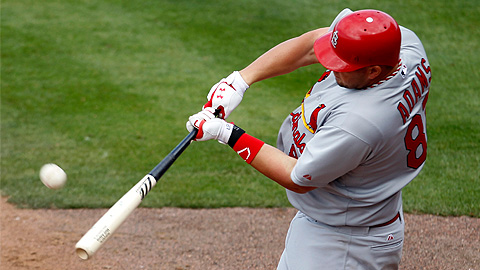 Matt Adams connects on his seventh-inning grand slam Tuesday.
